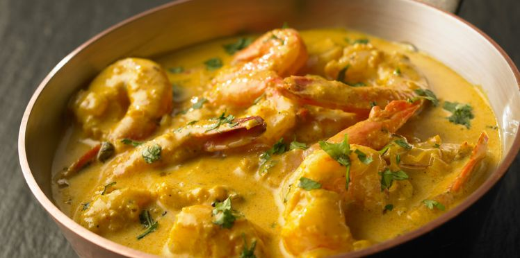Scampis au lait de coco au curry, thym frais et galangal